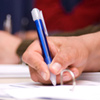 Image of hand holding a pen